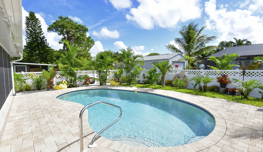 Pool and Back Yard of Foxtail Palms Retreat, a Bradenton Vacation Home Rental